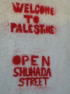 Graffiti in Hebron calls for the opening of Shuhada Street, a major market street closed to Palestinians by Israeli occupation forces. — Photo by Philipp Lausberg