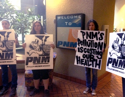 Protesters outside a PNM shareholder meeting. Image from 350 New Mexico.