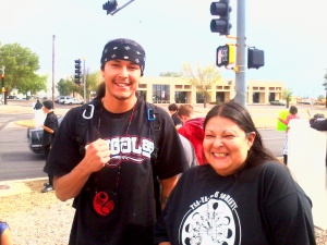 Anna Rondon and her son, Cooper Curley, attend a protest outside the U.S. Forest Service office in Albuquerque in May.